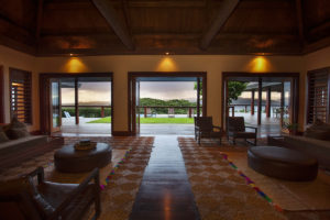 open lounge with natural wood in a private villa in fiji